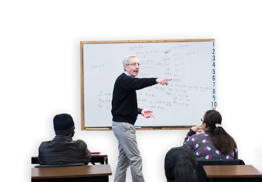 man teaching students in a classroom